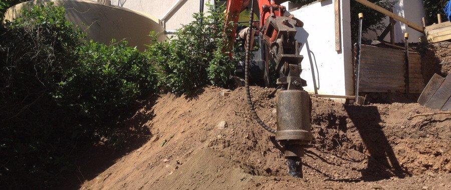 orange drill hammer truck