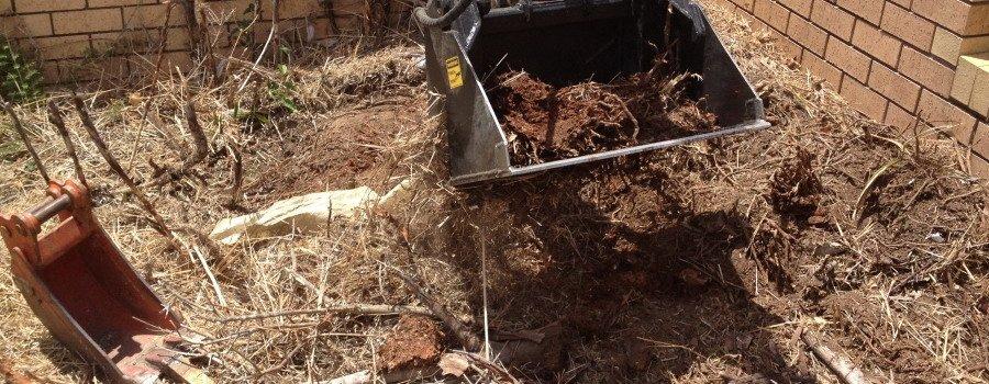 excavator bucket with soil