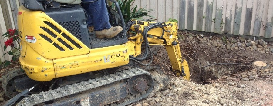 man operating yellow excavator digged in