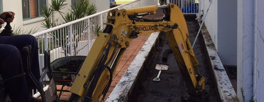 yellow truck excavator with shovel on ground