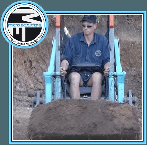 man operating sky blue excavator