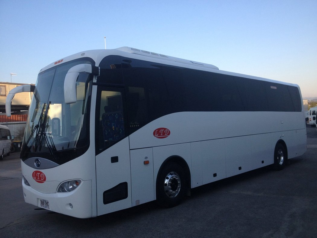 Coloured white bus available for dry hire services anywhere around the city of the Gold Coast