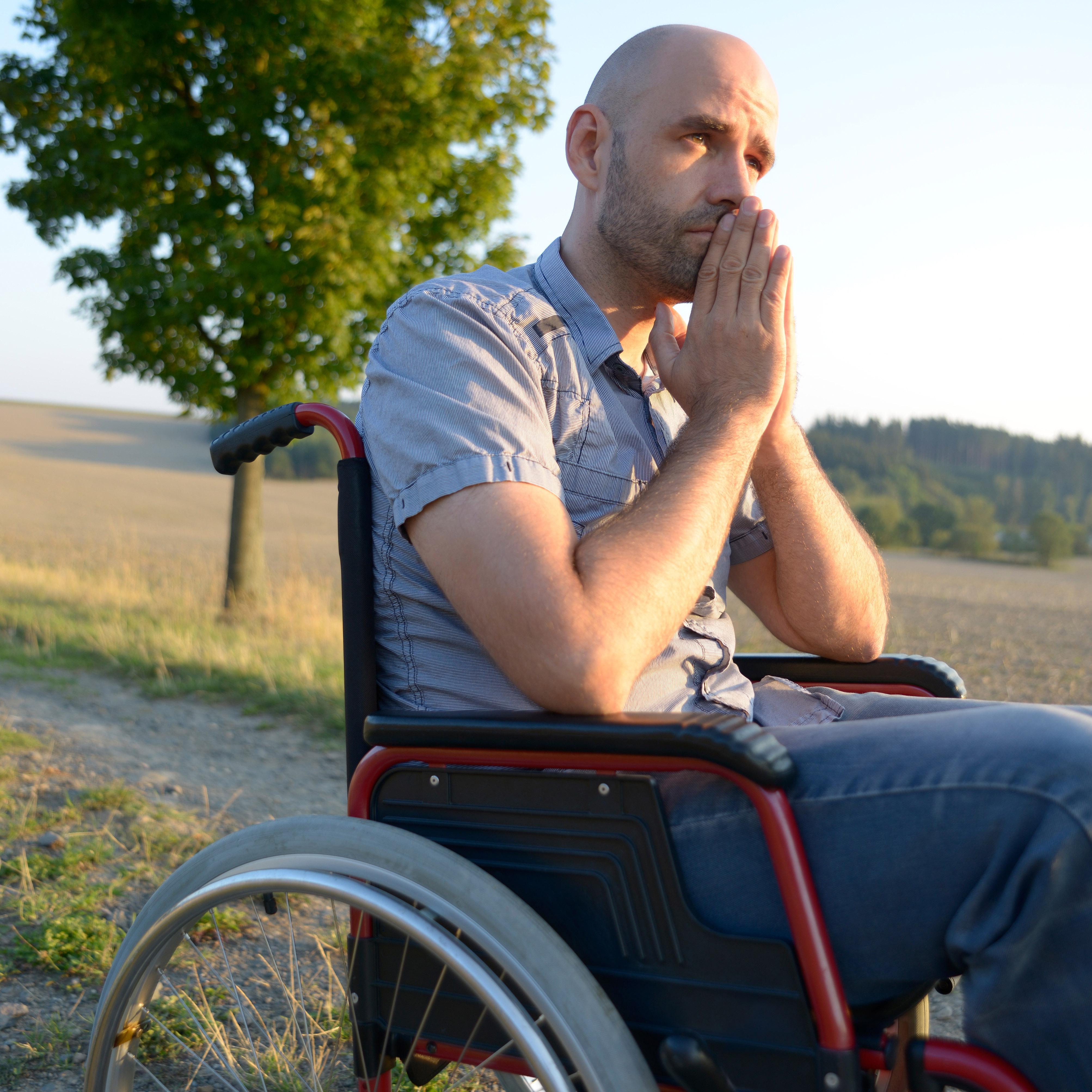 Sad man in a wheelchair