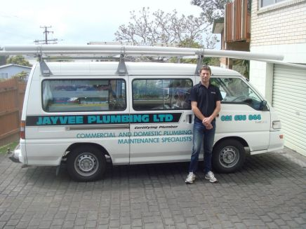 One of our plumbers in front of a van in Auckland