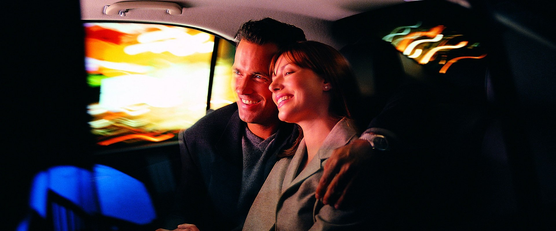 couple travelling in cab
