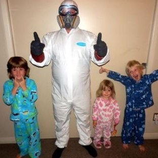 Happy kids posing with a Pest Control Expert