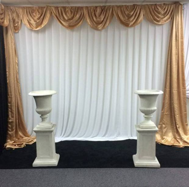 White chiffon wall draping with gold satin Venetian scallop and side drapes