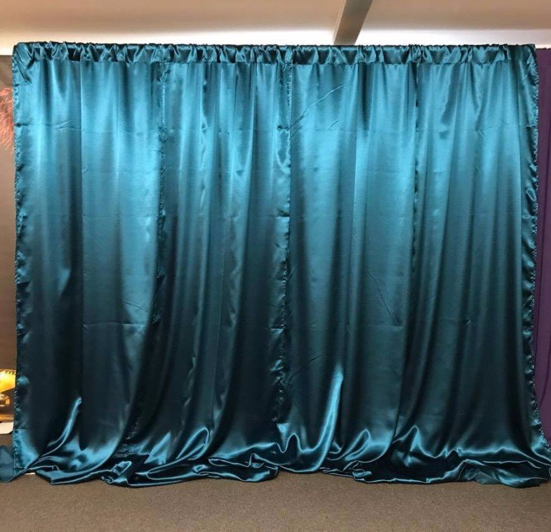 Turquoise satin wall drapes
