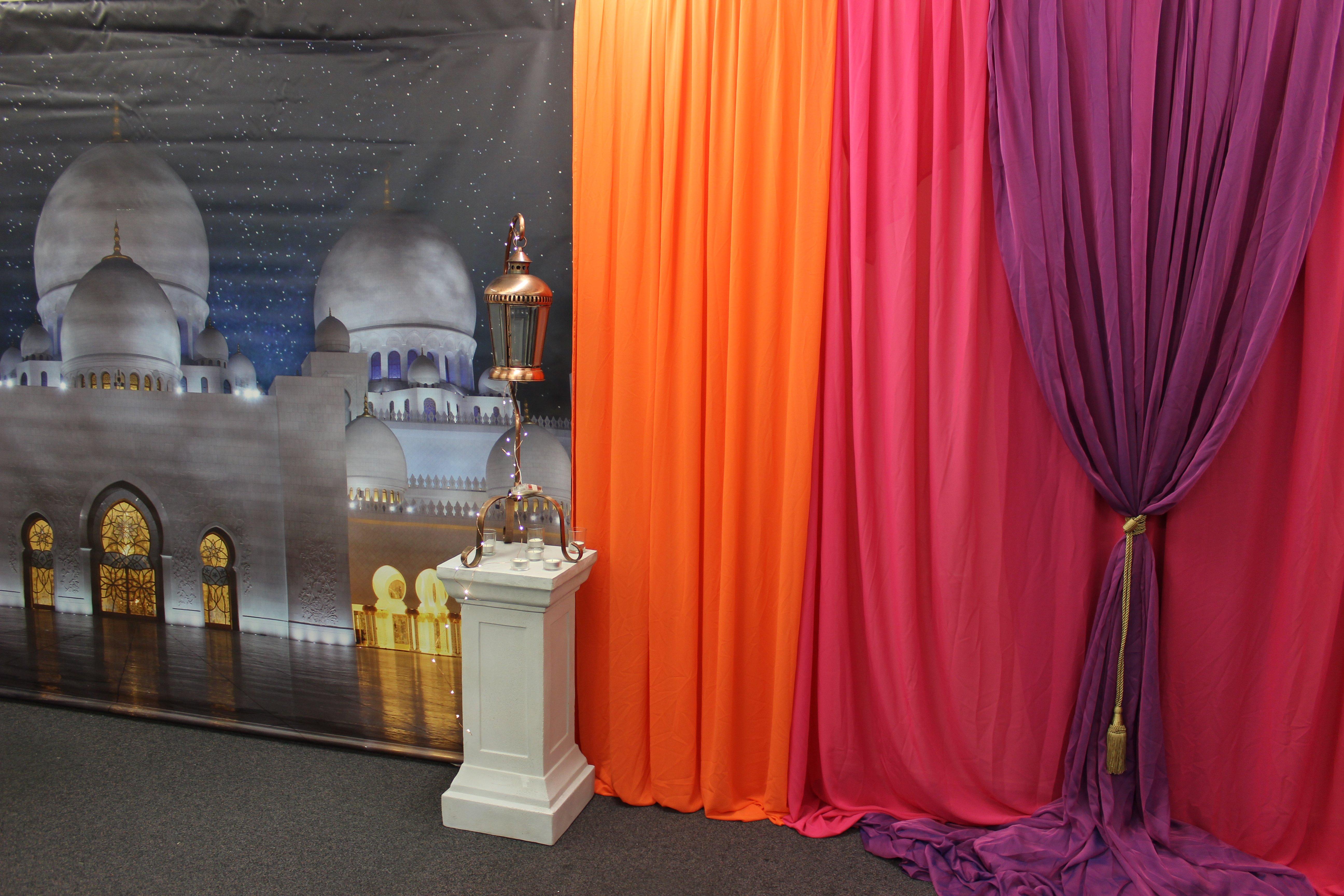 Orange, pink & purple draped backdrop