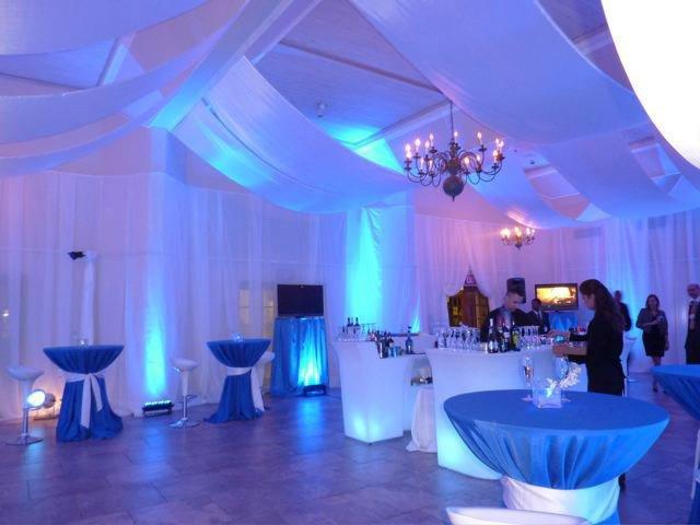 White chiffon drapes with blue wall wash lights