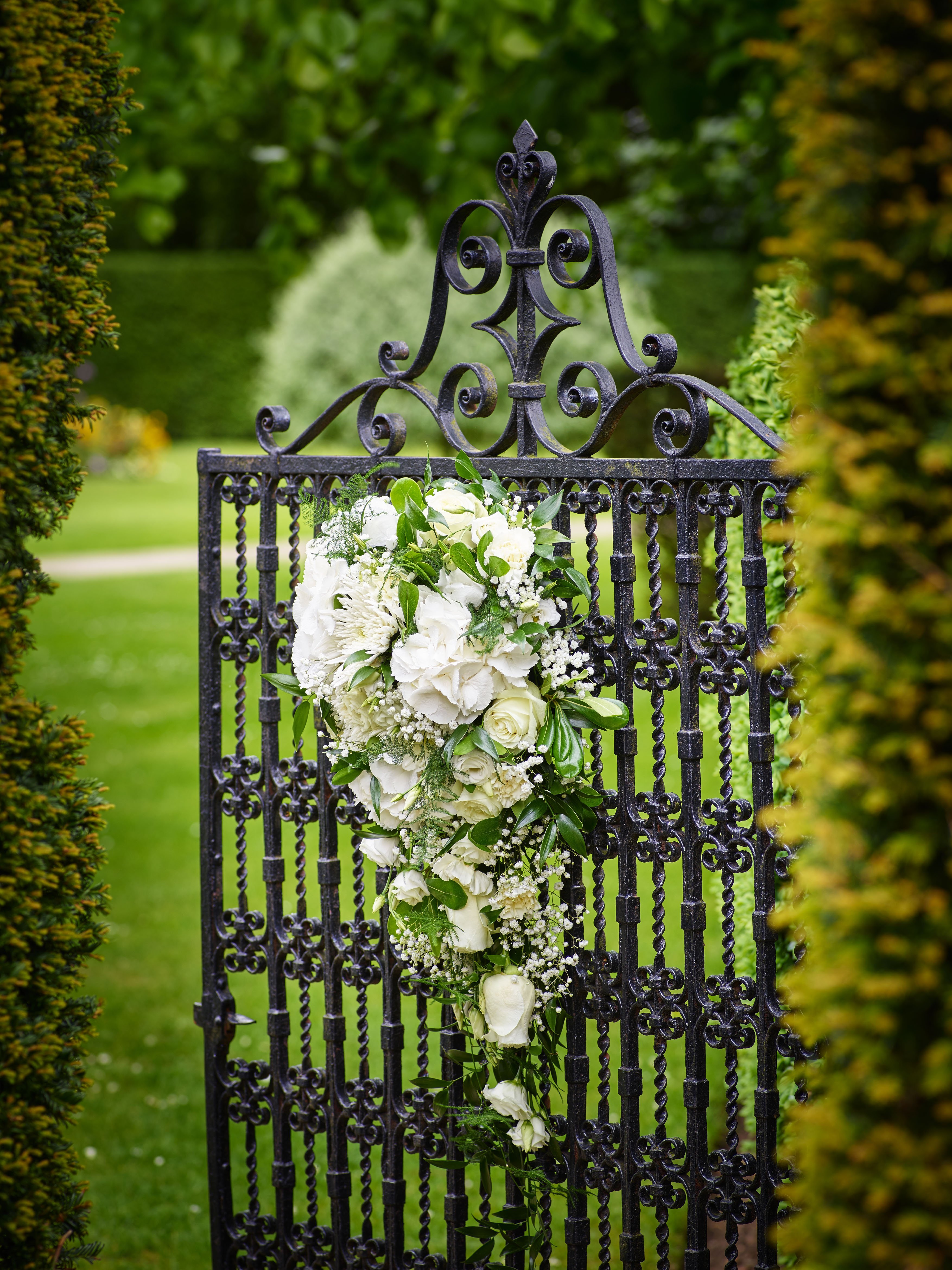 flowers hung on the gate