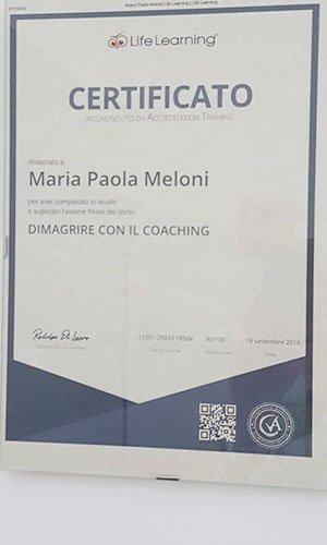 certificato a nome Maria Paola Meloni con scritto dimagrire con il coaching