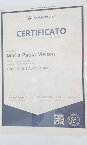 certificato a nome Maria Paola Meloni con scritto educazione alimentare