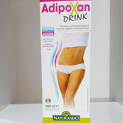 una confezione bianca e rosa di cartone con scritto AdipoXan Drink
