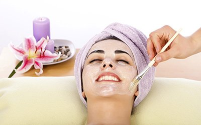 silk beauty clinic young woman smiling while facial