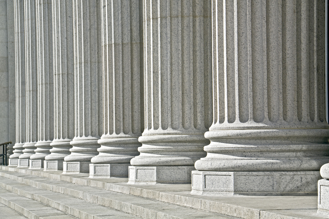 Roman columns symbolizing legal support with family law attorneys Anchorage, AK