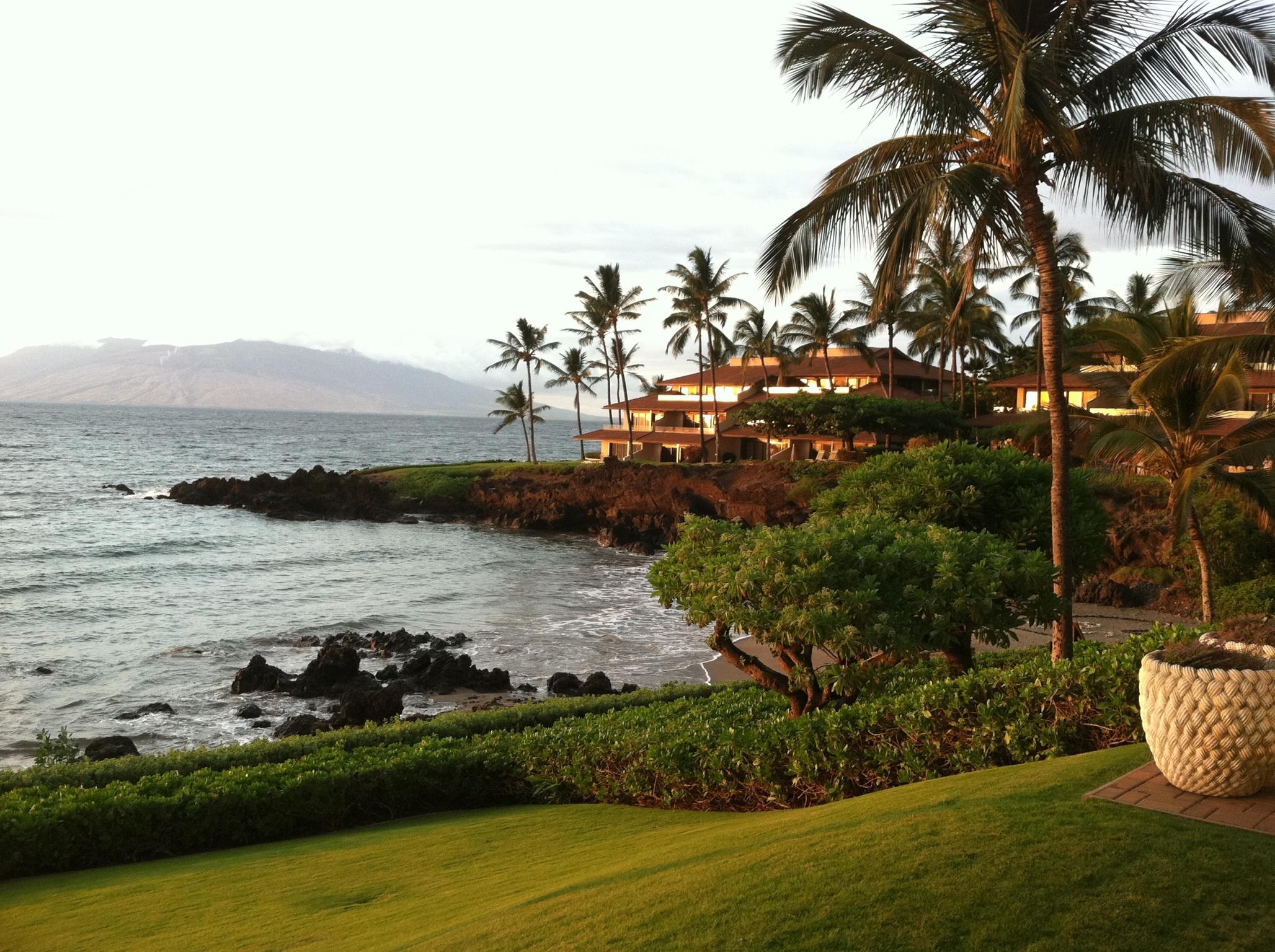 Beautiful Hawaiian sunset overlooking the Pacifc Ocean in Maui backyard