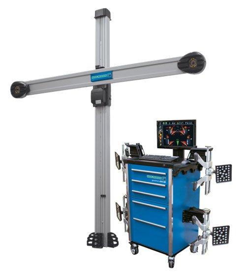 un carrello con dei cassetti, sopra un monitor e un macchinario