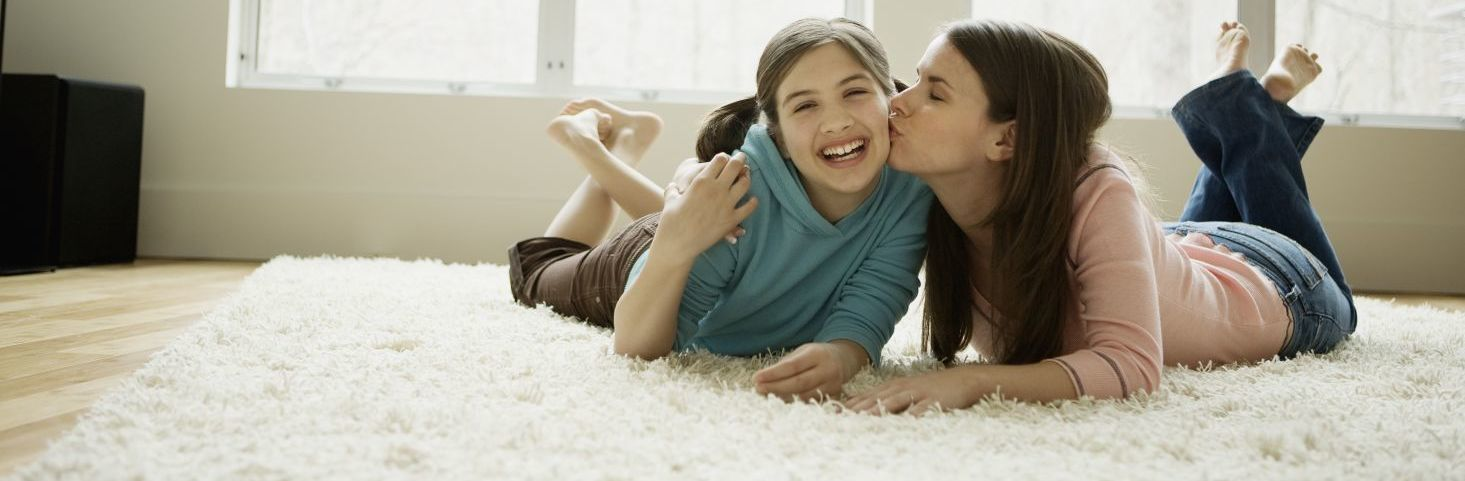 A mum and daughter on a rug after cleaning services in Auckland