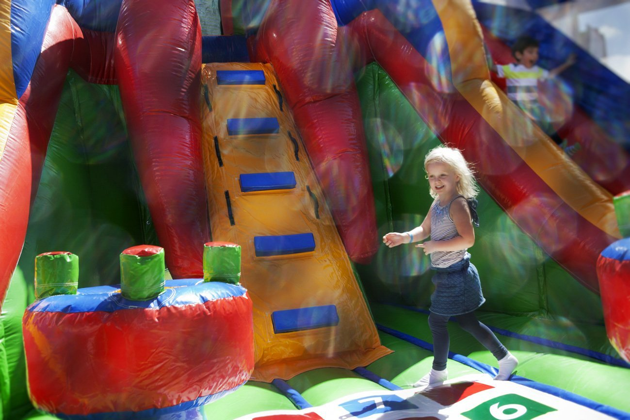 young girl near the step of the slide