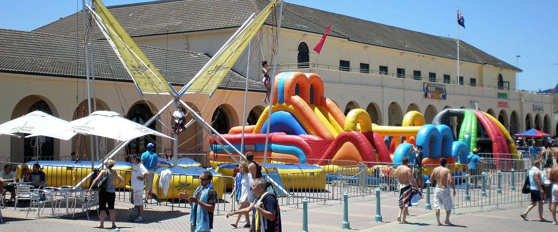 Young girl climbing onto the inflatable castle