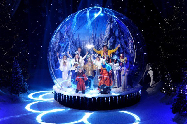 People enjoying in snow globe