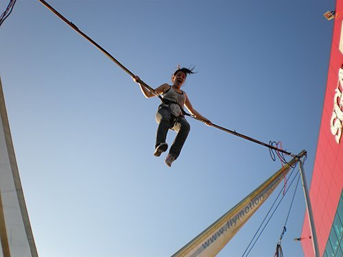 Young girl enjoying in bungy trampoline