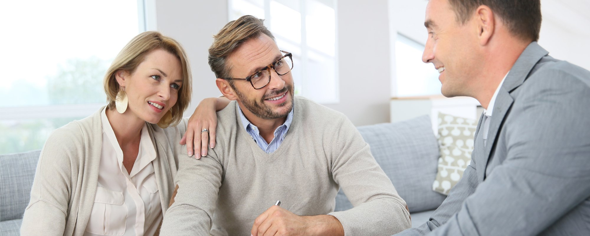 Young couple taking financial investment advice from the expert