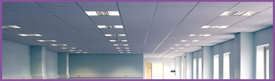 A suspended ceiling in a long blue office