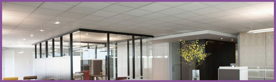 A large office and a meeting room divided by a glass partition wall