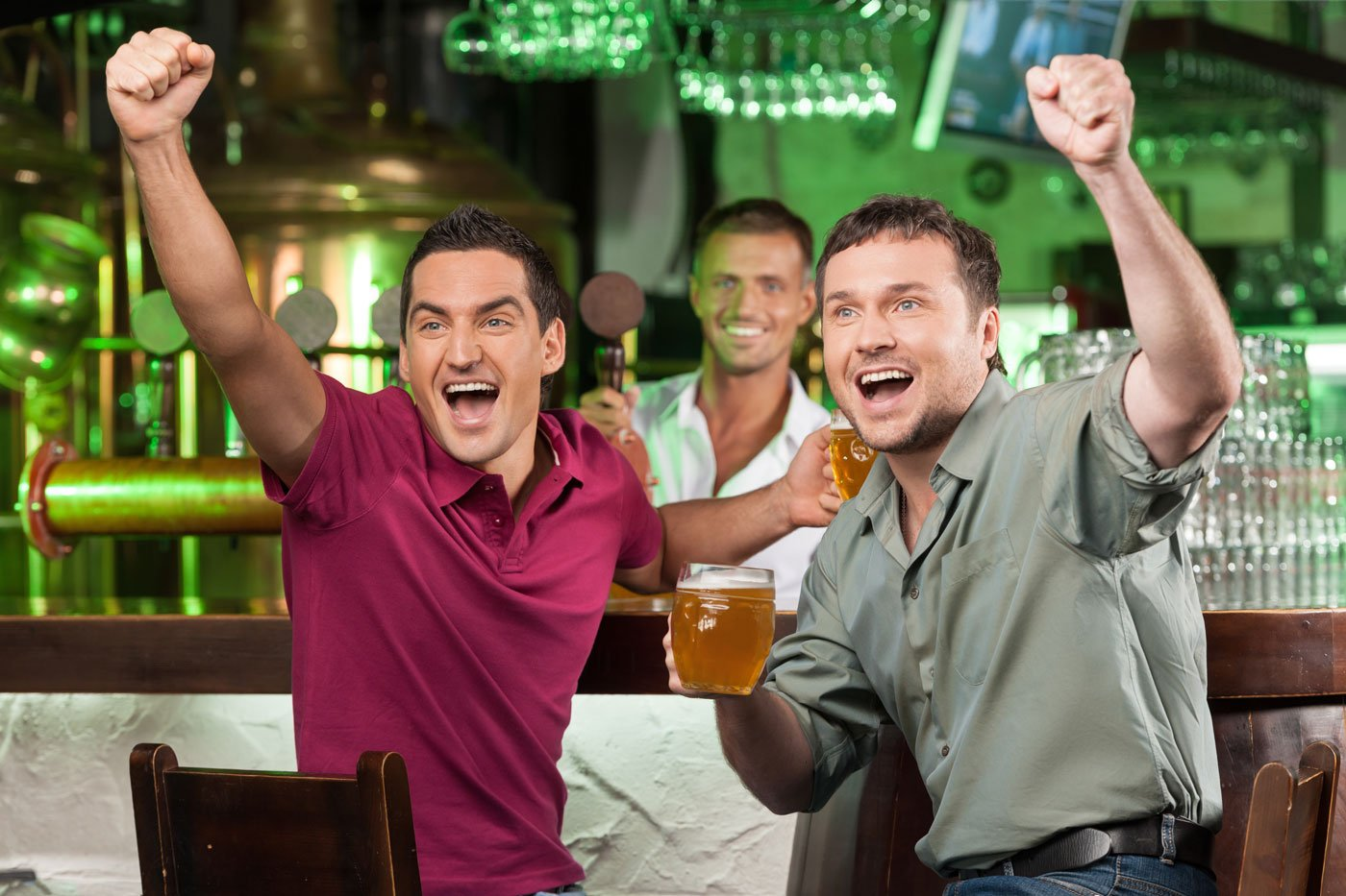 Group of friends celebrating with beer mug in hand