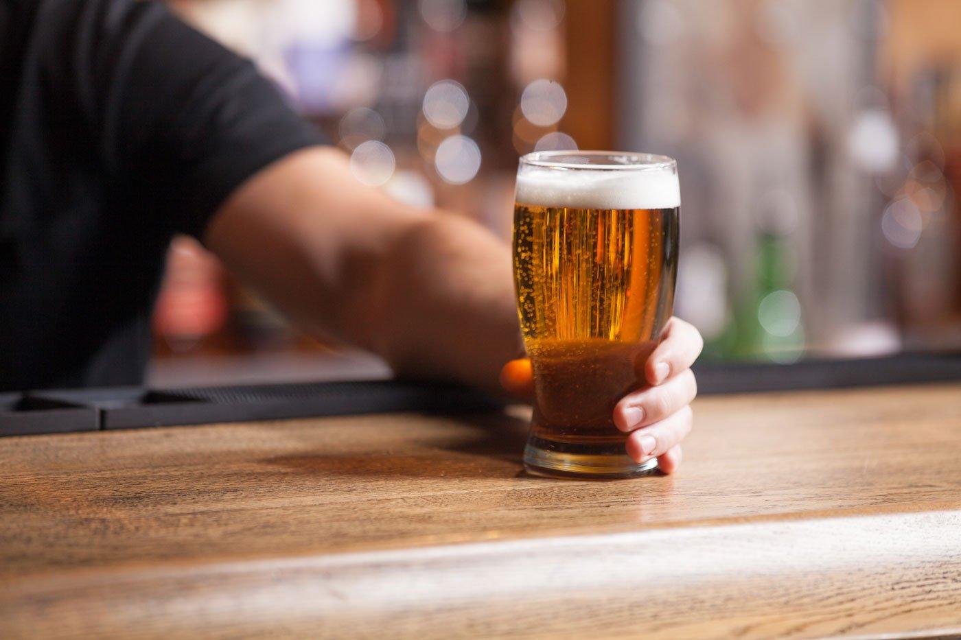 Individual holding a beer mug