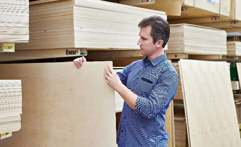 Individual choosing a plywood