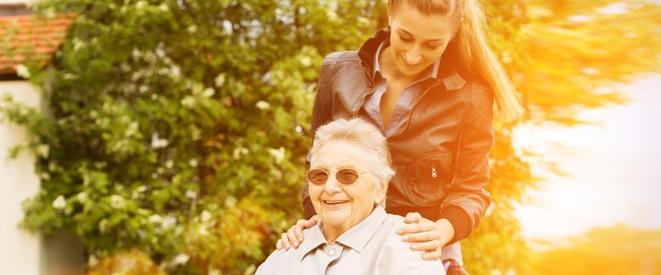 care worker taking the elderly out