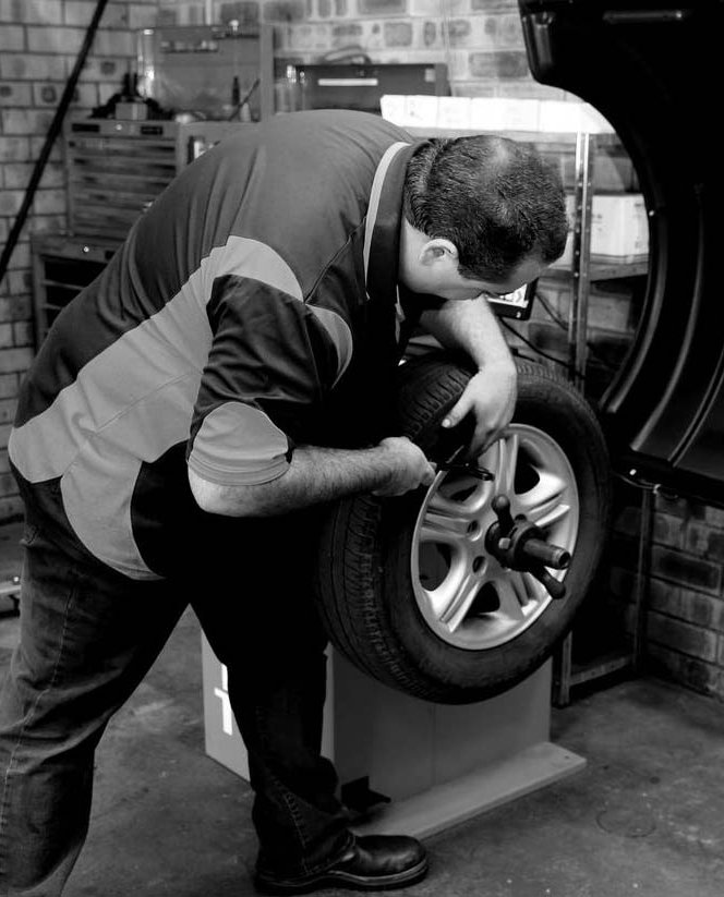 Man providing a tyre fitting in Wollongong