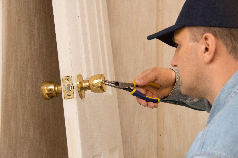 Locksmith repairing lock