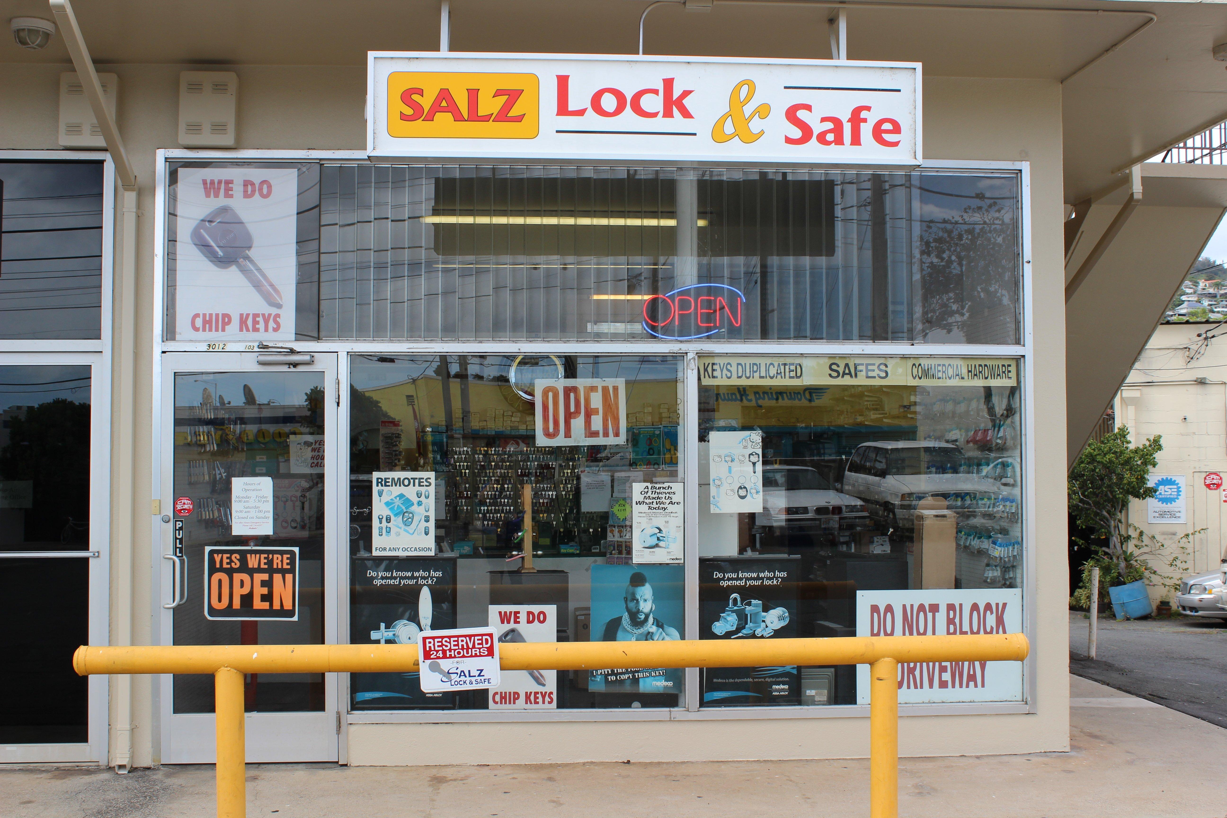 Locksmith placing new door lock