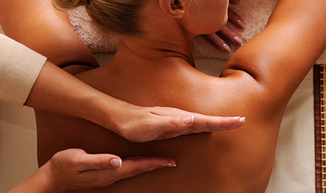 Close image of the back of a woman receiving a massage