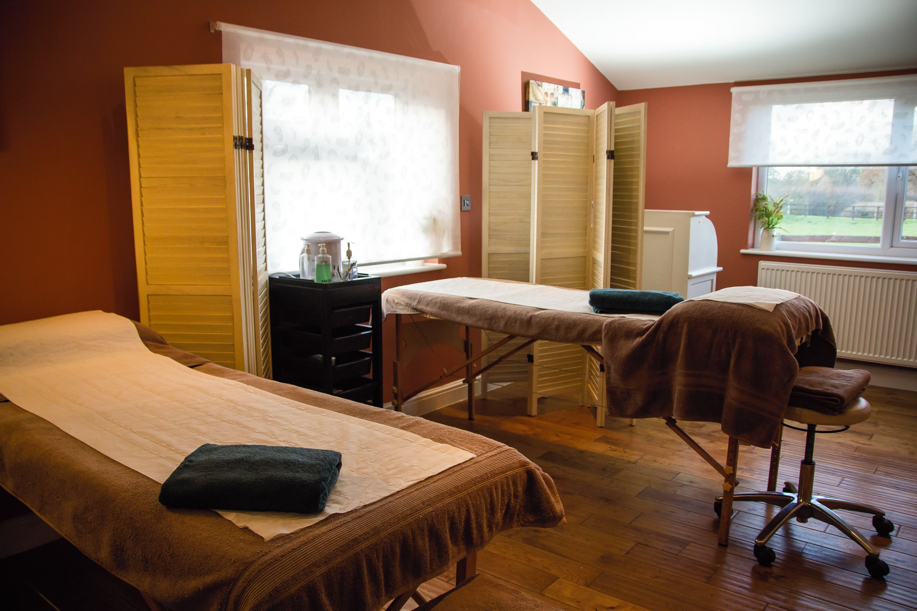 Photograph Of A Room Containing Two Massage Beds