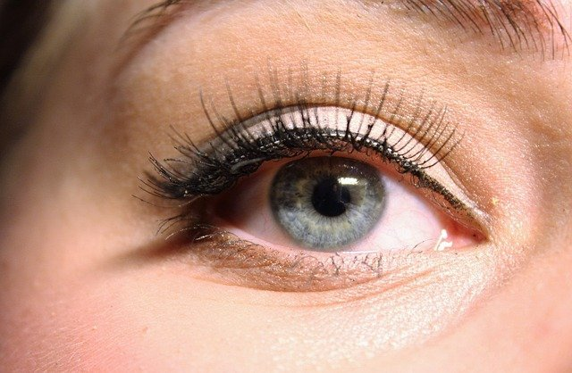 Close up image of the eye of a woman with long eyelashes