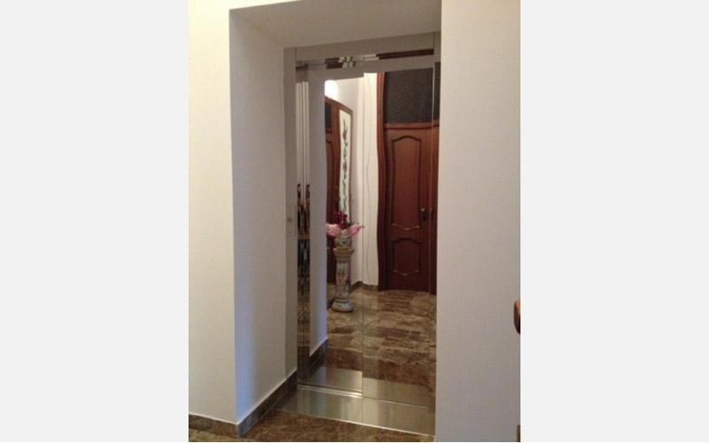 porta ascensore a specchio