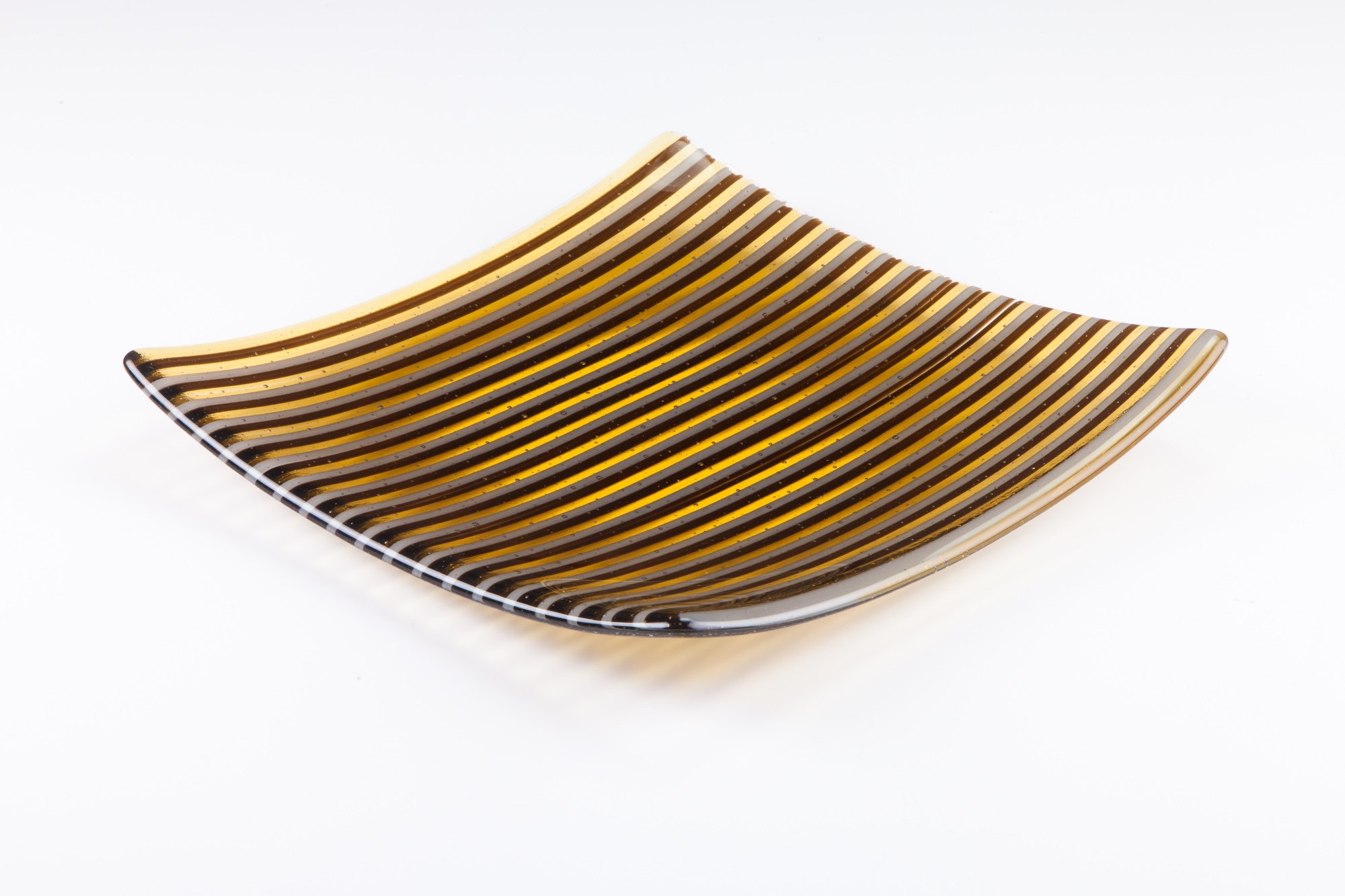 plate with golden coloured lines