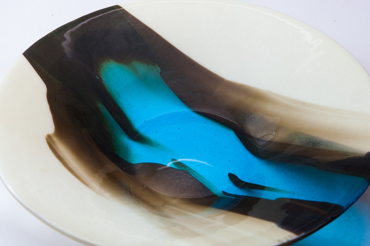 blue and black coloured glass