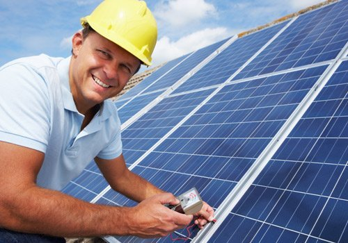 sparklite electrical man checking charge of solar panels