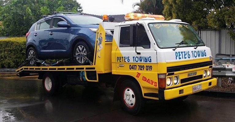 petes towing van towing a car