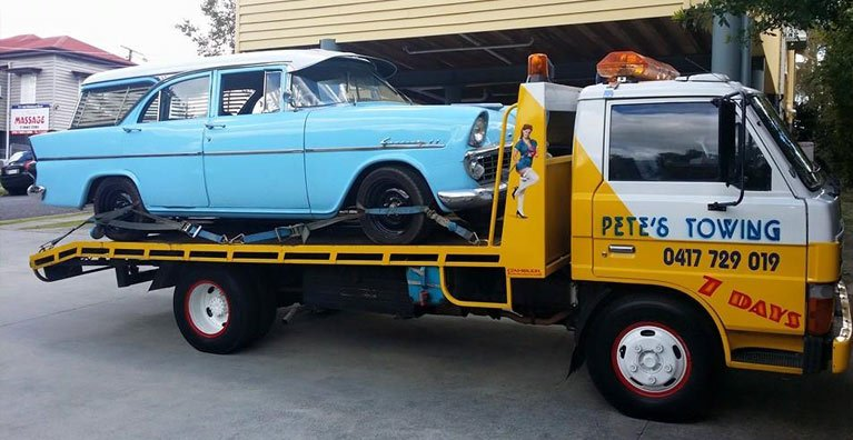 petes towing car towing on roadside