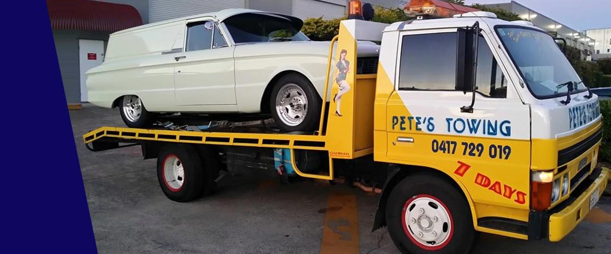 petes towing van towing car