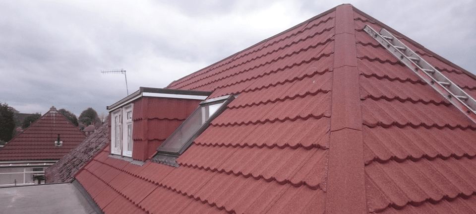 A white Velux window in a red roof