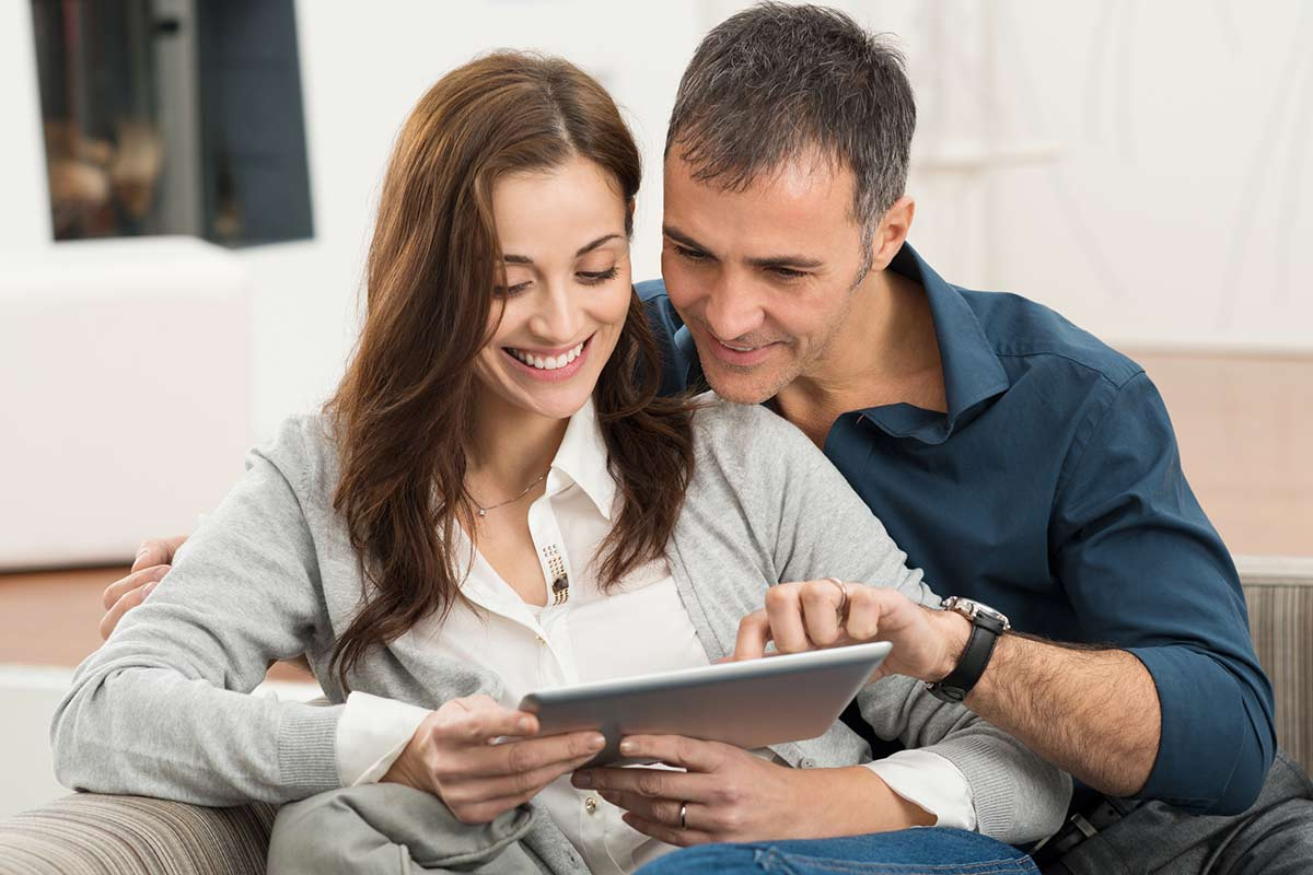 happy couple using the chris darby strata owner portal login