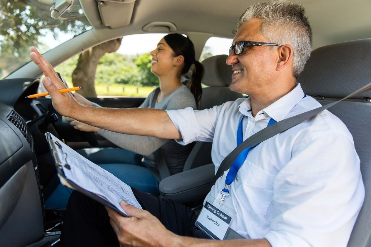 driving instructor giving directions